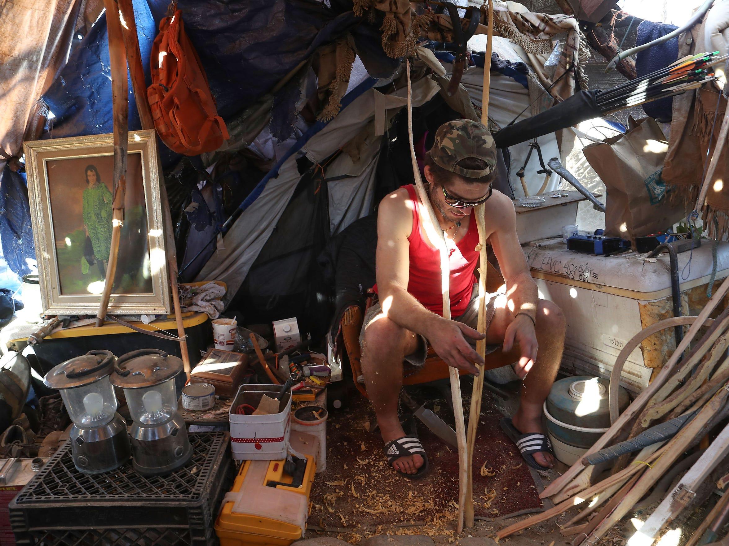 Inside of his makeshift home David Donzanti contemplates