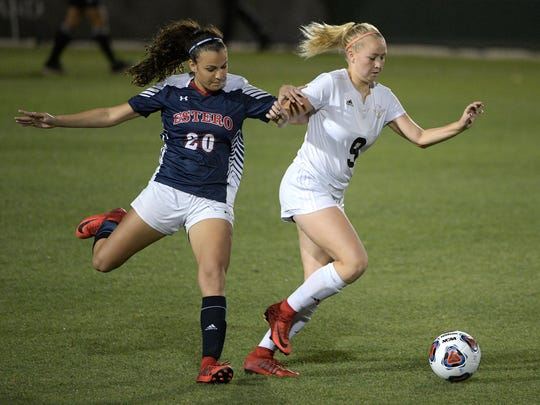 Estero's Sophie Restrepo (20) and Montverde Academy's Milla-maria Kujala (9) battle for possession of the ball during the first half of an Class 4A FHSAA State Soccer Championship game Friday, Feb. 23, 2018, in DeLand, Fla. (Phelan M. Ebenhack for the News-Press)