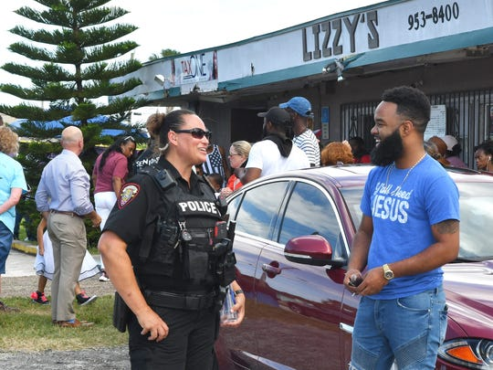 """A Sunday afternoon  """"Stop the Violence """" rally was held in front of Lizzy's restaurant at the corner of University Blvd., and Monroe Street in Melbourne. Community activists, Melbourne Police Department, and citizens joined up in speeches, music, and a march."""