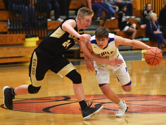 Cody Butler drives against Chase Whitehair during the