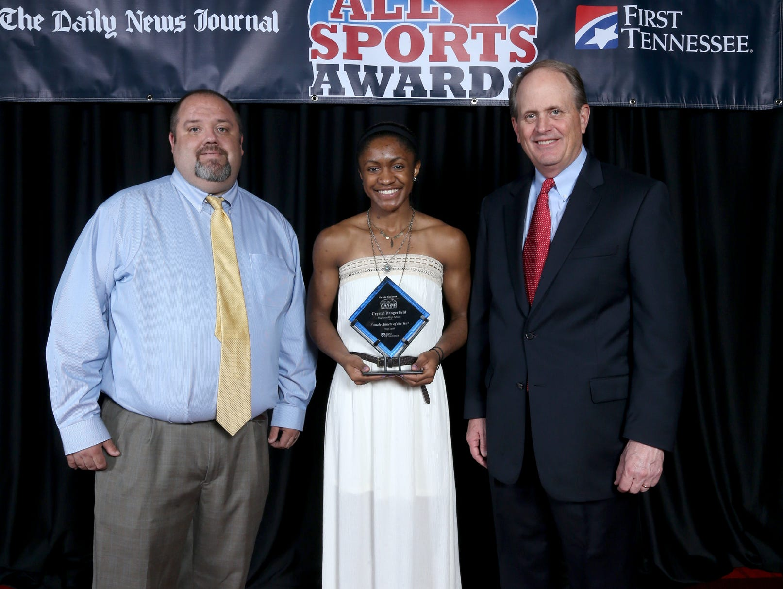 DNJ prep editor Tom Kreager, left, stands with Female Athlete of the Year Crystal Dangerfield and First Tennessee President Phil Holt at the 22nd Annual All Sports Awards Banquet on Sunday in Murfreesboro.