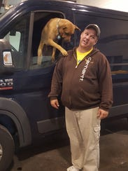 Allan Chapman of Madison and his dog Cena have transported
