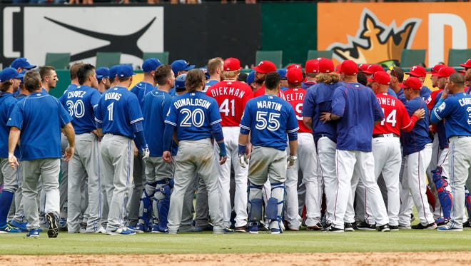 Blue Jays and Rangers clear the benches of Sunday's game.