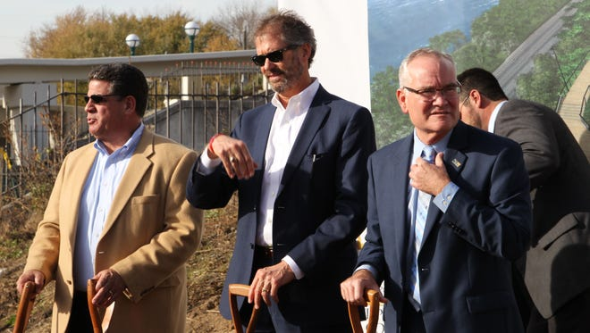 From left, Lafayette Mayor Tony Roswarski, West Lafayette Mayor John Dennis and Tippecanoe County Commissioner Tom Murtaugh prepare to participate in a groundbreaking ceremony for the Riverside Promenade construction project on Nov. 17, 2016, by Riehle Plaza in Lafayette.