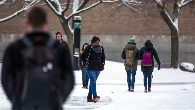 Students walk on campus between classes at the University of Wisconsin-Stevens Point Jan. 23, 2018,  in Stevens Point.