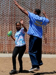 Taniya Ellis, 12, plays football with her father and