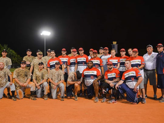 Louisville Slugger Warriors pose with the Bonita Springs Fire Department softball team during the First Responders-Warriors Cup on Veteran's Day.