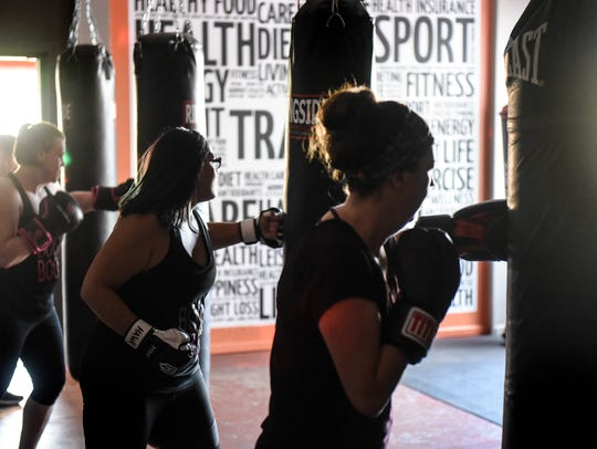 Class members punch during a Spicy Boxing class Tuesday,