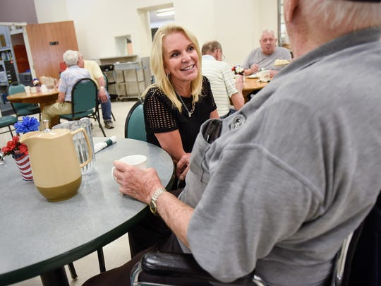 State Sen. Karin Housley smiles while talking with seniors during a visit Thursday, July 19, to the Whitney Senior Center in St. Cloud.