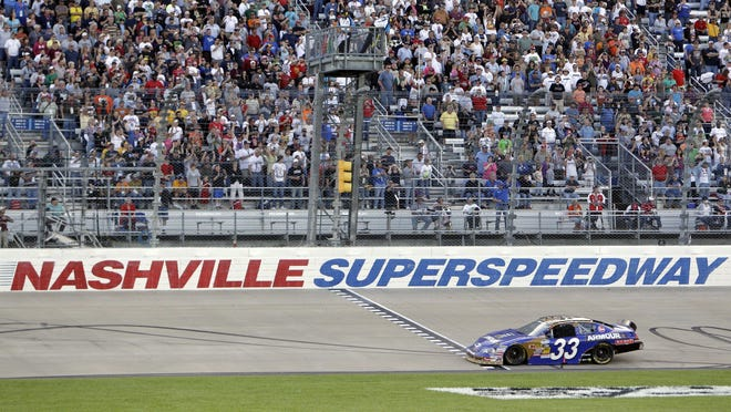 FILE -- In this April 3, 2010, file photo, Kevin Harvick takes the checkered flag at the finish line to win the NASCAR Nationwide Series Nashville 300 auto race at Nashville Superspeedway in Gladeville, Tenn. NASCAR is set to return to the track in 2021. Nashville Superspeedway will hold a Cup race for the first time next season.  It ends NASCAR's decade-long drought at the track.