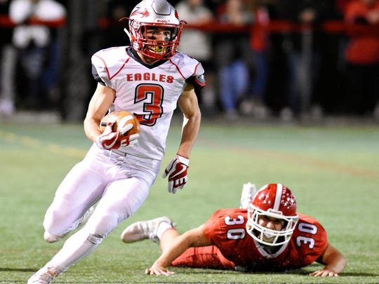 Dover's Derek Arevalo, left, runs the ball against Susquehannock in a game last season. Arevalo is one of four Dover running backs averaging 6.9 or more yards a carry. DISPATCH FILE PHOTO.