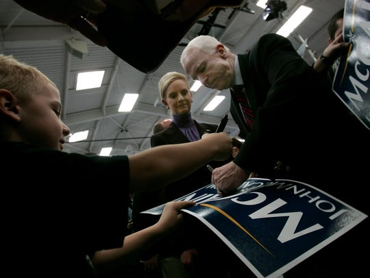 2008: John McCain signs an autograph for Mason Coverstone during his campaign stop at Montgomery Bell Academy Saturday, February 2, 2008 in Nashville, Tennessee. (Dipti Vaidya/Staff