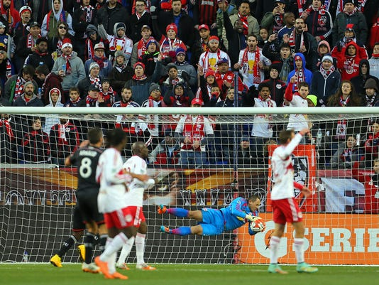 New York Red Bulls goalkeeper Luis Robles (31) makes a diving save against D.C. United during the first half of an MLS playoff soccer match, Sunday, Nov. 2, 2014, in Harrison, N.J. (AP Photo/Adam Hunger)