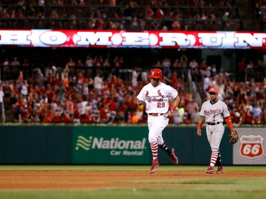 St. Louis Cardinals' Tommy Pham (28) rounds the bases after hitting a two-run home run as Washington Nationals shortstop Wilmer Difo watches during the eighth inning of a baseball game Sunday, July 2, 2017, in St. Louis. (AP Photo/Jeff Roberson)
