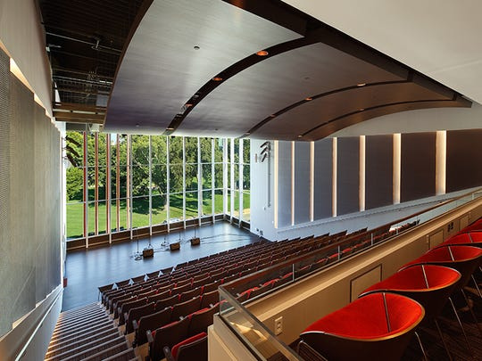 The Cedar Rapids Public Library included a 200 seat auditorium, which includes widows behind the stage looking toward Greene Square.