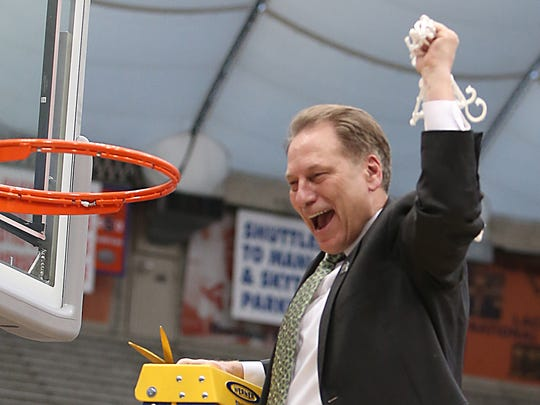 Michigan State head coach Tom Izzo celebrates with his team after the 76-70 overtime win against the Louisville Cardinals in the NCAA East Regional Final on Sunday, March 29, 2015 at the Carrier Dome in Syracuse.