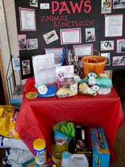 $538.00 in cash and $300.00 in supplies went to Helping Paws Animal Sanctuary Supply Drive at Woody's Waterside in St. James City.