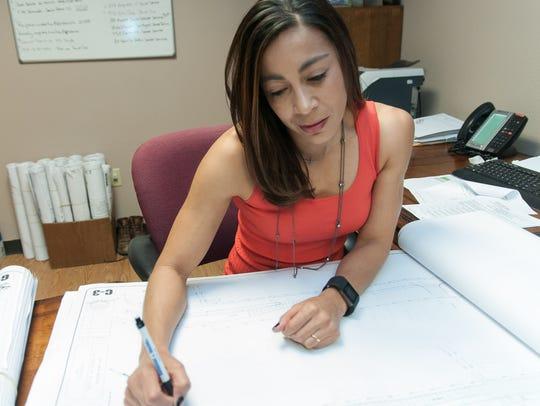 Rachel Bustos, president of Burn Construction Co.,