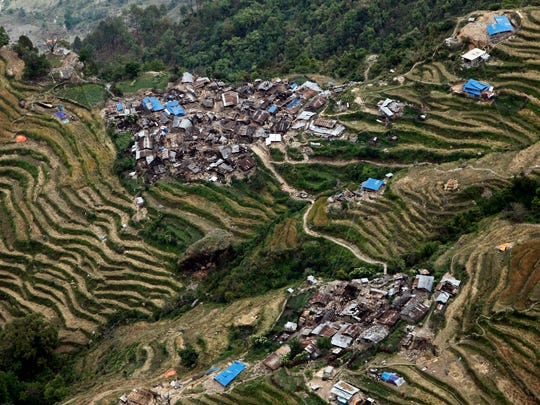 Destroyed villages sit on mountain tops near the epicenter