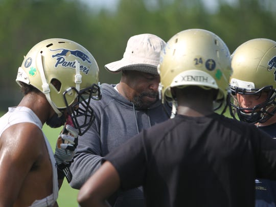 Cedric Jones works with his John Paul II offense during last year's fall practices. After two years turning the Panthers into NFCC finalists, Jones has moved on to alma mater FAMU DRS.