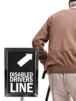 After an encounter with the Iowa DOT in which she was asked to schedule a driver's test, one Des Moines woman is asking whether the department discriminates based on physical disabilities.