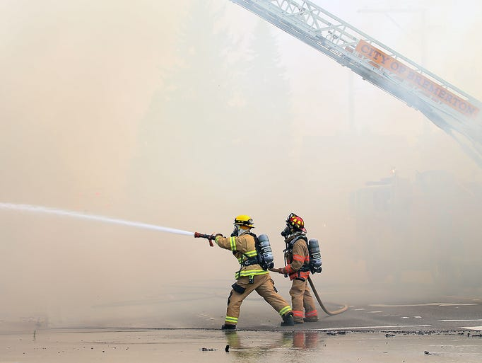 Bremerton firefighters Cody Hoefs and Capt. Brian Marceau