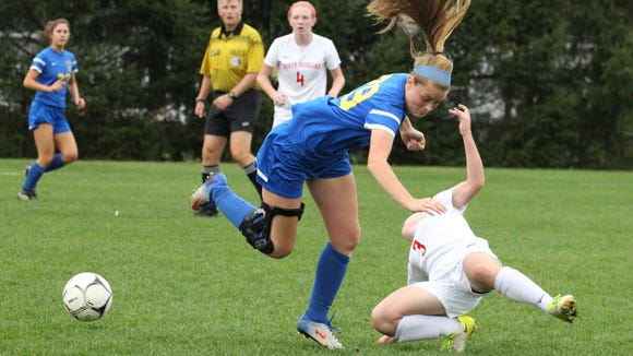 Mahopac's Emma Goodrow collides with North Rockland's Olivia Csernecky during their Section 1 Class AA girls soccer quarterfinal at North Rockland Oct. 25, 2017. Mahopac won 2-1.