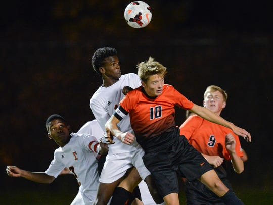 St. Cloud Tech's Mohamed Abdi, left center, and Moorhead's