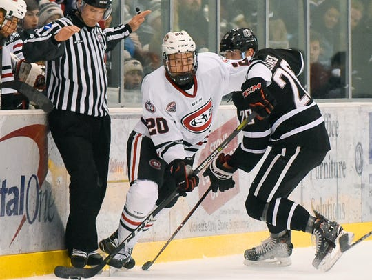 St. Cloud State's Will Borgen skates with the puck