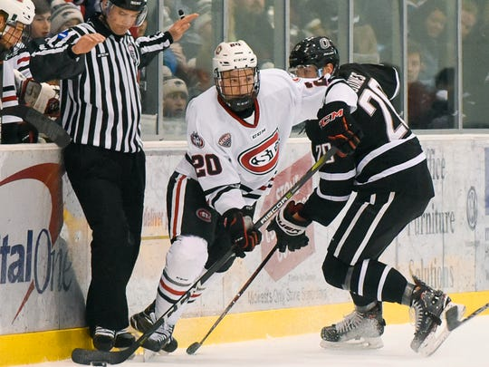 St. Cloud State's Will Borgen skates with the puck against Nebraska-Omaha during the first period Saturday, Feb. 3, at the Herb Brooks National Hockey Center.