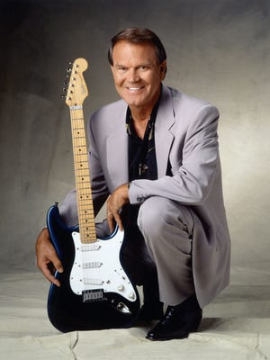 Glen Campbell, in later years, with guitar.