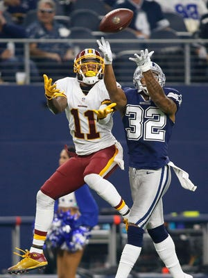Dallas Cowboys cornerback Orlando Scandrick (32) breaks up a pass intended for Washington Redskins wide receiver DeSean Jackson (11) in the third quarter at AT&T Stadium. Dallas won 31-26.