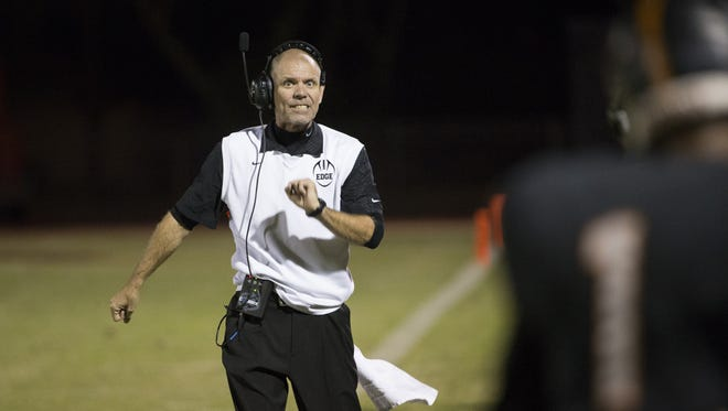 Desert Edge's  Rich Wellbrock yells to his team while playing Verrado during the first round of the State Playoffs at Desert Edge High School on November 4, 2016 in Goodyear, Ariz.