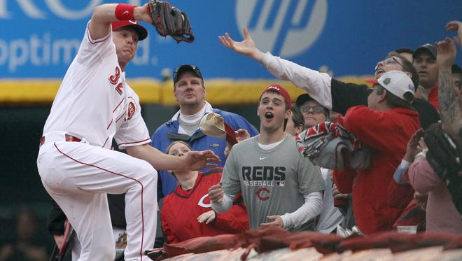 Reds right fielder Jay Bruce catches a ball in foul territory for the final out of Cincinnati's 5-2 Opening Day win against the Pittsburgh Pirates at GABP on Monday.