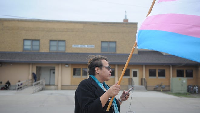 Isabella Red Cloud stands in front of the Union Gospel Mission Saturday April 29, 2017, a week after she was denied service from the organization for wearing female clothing.