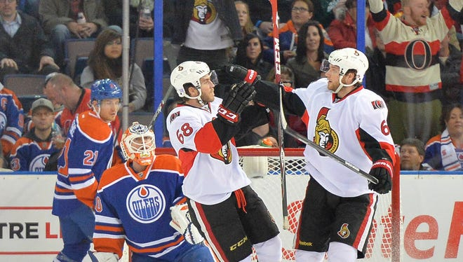 Senators' Mike Hoffman and Bobby Ryan celebrate the first of Hoffman's two goals in Ottawa's 4-3 overtime win.