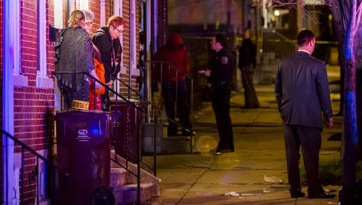 Wilmington Police officers investigate the scene of a shooting in the 1100 block of Elm Street in Wilmington on March 30.