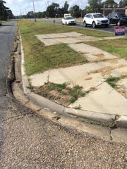 A non-ADA compliant sidewalk in Shreveport.