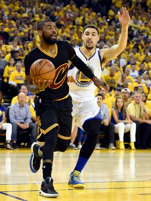 Cleveland Cavaliers guard Kyrie Irving (2) and Golden State Warriors guard Klay Thompson (11) will be teaming up on USA Basketball.