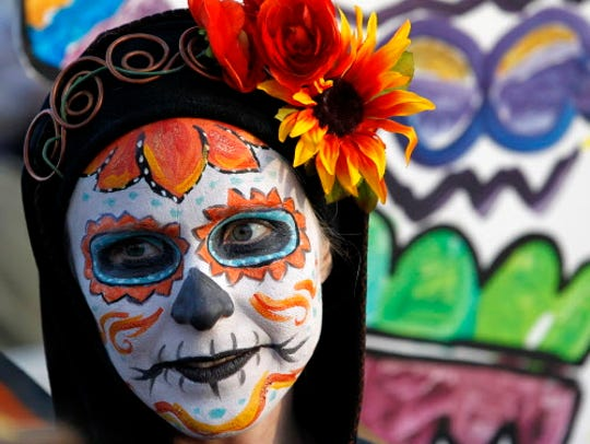 Face painting and a parade are part of the Day of the