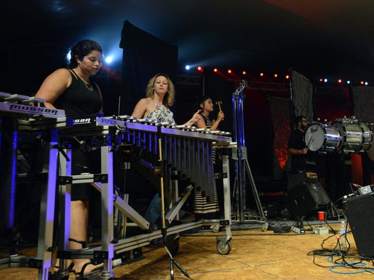 Members of the Lancaster High School Percussion Ensemble performed with TUSK Wednesday night, July 26, 2017, at the Ohio University Lancaster Wendel Concert Stage in Lancaster. The Fleetwood Mac tribute band performed as part of the Lancaster Festival.