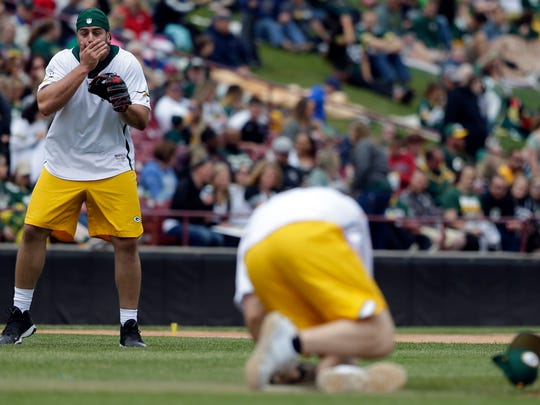 David Bakhtiari reacts as Clay Matthews is hit by a
