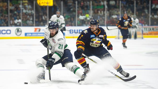 Florida Everblades player David Dziurzynski (21) faces off against Colorado's Matt Garbowsky (7) during Game 3 of the Kelly Cup Finals at Germain Arena on Wednesday. Colorado won, 5-4, in overtime to take a 2-1 series lead.