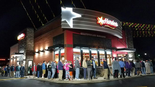The line snaked around the building at 4:30 am Tuesday awaiting the 5 am opening of the new Hardee's Restaurant in Fairview.