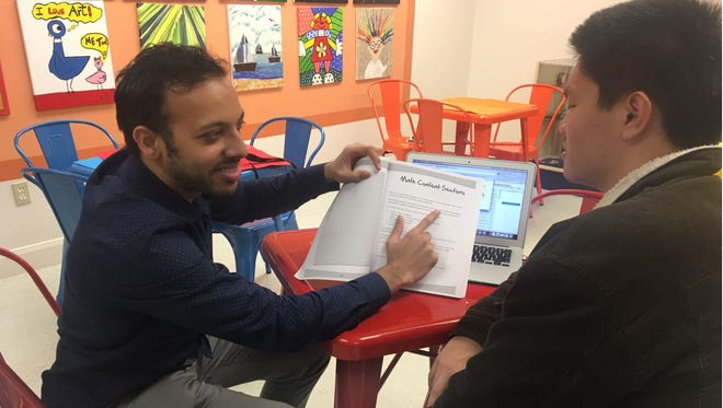 Ajmal Saleem, left, speaks with Fint Yu, a tutor at Suprex Learning LLC in Houston, where Saleem is the director. The private tutoring and test preparation business also has offices in Chicago and New York.