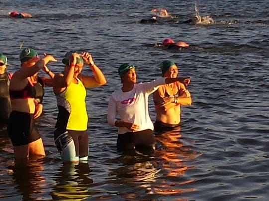 Stephanie Testa, 45, points out at the swimming course before starting the Ron Jon Cocoa Beach Triathlon.