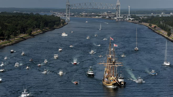 With the Railroad Bridge as a backdrop, the Mayflower II makes its way through the Cape Cod Canal Monday morning on its way to its homeport in Plymouth.