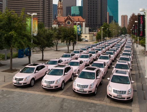 All the pink Cadillacs are lined up for the Mary Kay 50th Finale
