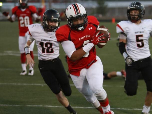 Central High School running back Garrett King gets past the defense during a homecoming game against Buffalo at Harrison Stadium.