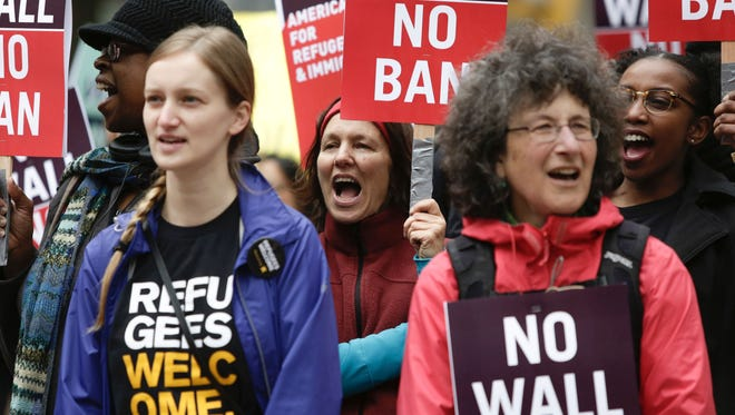 People protest outside as the 9th Circuit Court of Appeals prepares to hear arguments on President Trump's revised travel ban in Seattle, Wash., May 15, 2017.